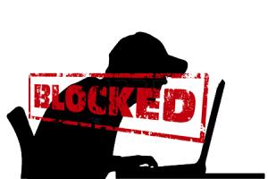 man-sitting-at-a-computer Blocked small